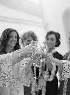 Bridesmaids sharing a champagne cheers with their bride at the Milwaukee Art Museum! As seen on Style Me Pretty. >> Photo by The McCartneys Photography www.meetthemccartneys.com