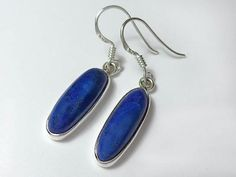 Oval sterling silver earrings with beautiful cabochon lapis lazuli gemstone and fine details throughout.