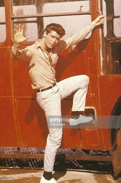 Photo of Cliff RICHARD; still from film 'Summer Holiday' - climbing onto bus