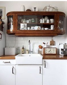 Antique Wall Mounted Oak & Glass Cabinet | White Brick Backsplash