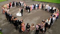 I would love to do something like this with everyone that comes to our ceremony.  This wedding photo would be so great to put up on our wall!!!