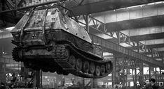 """A 72 ton """"Ferdinand"""" hoisted above the Nebelungenwerk assembly plant in Sanct Valentin Austria. When the Germans decided to turn them into TD's the Casemate was constructed by Alkett."""