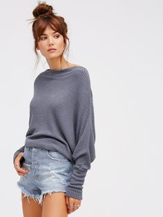 Mercury Tee   So-soft drippy thermal top featuring a wide neck and oversized, slouchy silhouette. Rounded hem and exposed seams.