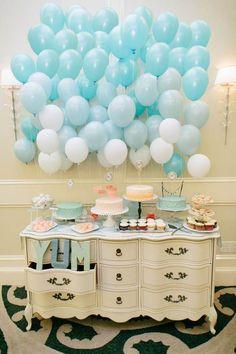 blue balloon wedding backdrop and wedding cake display