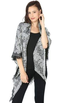 2d5172132a8f Any woman would love the gift of this floral sweater wrap. Find it at  Fairweather