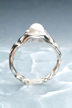 Custom silver band with a pearl created at Panurgic