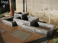 SPACKLE STYROFOAM WITH CONCRETE OR USE CONCRETE BOARDS..... TO CREATE A FOUNTAIN OR A PLANER BOX.