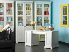 Neon yellow accents complement this white and blue home office by Brian Patrick Flynn.