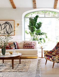 A few too many patterns for my liking but I love layering rugs, the stark window (airy outdoor feel and well-framed but not treated). The hardwood and white walls remind me of our place, though our floors are a bit darker/redder