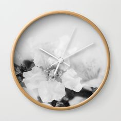 """Black And White Blossoms Wall Clock by ARTbyJWP via Society6 #wallclock #homedecor #wallart #walldeco #clock -  Available in natural wood, black or white frames, our 10"""" diameter unique Wall Clocks feature a high-impact plexiglass crystal face and a backside hook for easy hanging. Choose black or white hands to match your wall clock frame and art design choice. Clock sits 1.75"""" deep and requires 1 AA battery (not included)."""