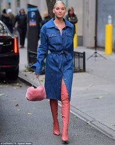 It's a cinch! The model's jean frock was belted at the waist to accentuate her enviable figure