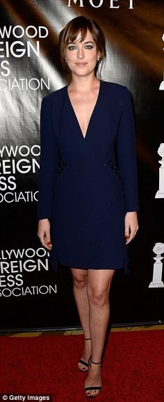 Simply chic: Dakota Johnson opted for understated elegance in a midnight blue dress...