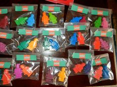 "Home made crayons using Lego man mold - ""I bought a few boxes of cheap crayons, soaked them to get the wrappers off easily, and then broke them into 5-6 pieces to put inside the mold. Then just put them in the oven for about 10 minutes to melt. I only needed one crayon per mold for these. I placed them in candy wrappers bought at Michaels and made an address label as a sticker to close them up."""