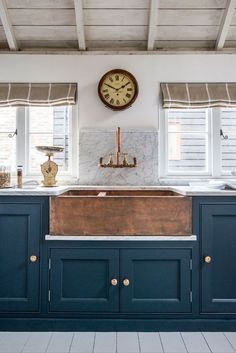 2018 Decor Trends for Kitchens! Blue cabinets, stone and copper sinks, heavy cabinetry, grays, creams and neutrals!