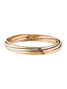 white, yellow and rose gold Cartier Trinity de Cartier rolling bangle featuring three yellow gold bangles, two white gold and two rose gold. Black Diamond Bracelet, Gold Bangle Bracelet, Diamond Bracelets, Gold Bangles, Jewelry Bracelets, Diamond Rings, Yellow Jewelry, White Gold Jewelry, Gold Jewellery