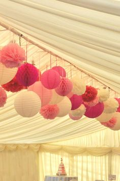 A remplacer par les couleurs voulues - Multiple pink shades - paper lanterns, pom poms and honeycomb balls for a marquee wedding