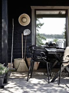 Porch | Black merges contemporary & rustic materials & styles for porch dining
