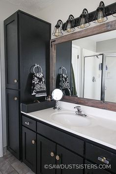 From nineties nightmare to farmhouse fabulous! This piece went from knotty alder yellow to a sleek black vanity. Get the details along with painting tips! Black Cabinets Bathroom, Black Vanity Bathroom, Master Bath Vanity, Bathroom Vanity Makeover, Master Bath Remodel, Master Bathroom, Black Bathroom Paint, Relaxing Bathroom, Downstairs Bathroom