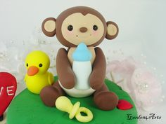 Customise Lovely Baby Monkey Cake Topper with Beautiful Base - for Baby Shower or Kids Birthday. $55.00, via Etsy.