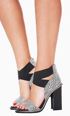 Have a monochrome moment with artsy etchings and elastic straps. A sturdy heel keeps the look comfortable.