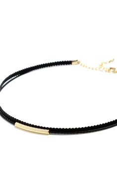 "The Wicked Cute Black and Gold Choker Necklace is perfect for channeling '90s throwback vibes that are totally on-trend! A black cord accented by a shiny gold charm joins with a skinny black ribbon to create a simple choker necklace that's perfect for layering or wearing alone. Necklace measures 12"" around with a 1"" extender chain."