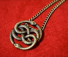 The Neverending Story pendant has been smuggled straight out of Fantasia and can now be yours to own. This pendant features the iconic intertwined snakes consuming each other and makes a great gift for children, adults, and any fan of this classic movie.