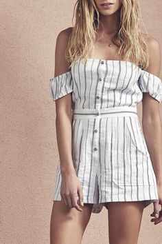Saylor The Laney Romper features an off-the-shoulder style with a buttoned front design a belt like band along the waist a shirred back design side and back pockets and a vertical striped print throughout. Laney Romper by Saylor. Clothing - Jumpsuits & Rompers Miami Florida