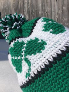 """This hat is worked in the knit stitch (aka the waistcoat stitch). This is what gives the hat a knit look. Ive used some Bernat Super Saver yarn (Worsted weight) and a 6 mm crochet hook. The pattern includes a simple chart for you to work while working the shamrock colour work."""