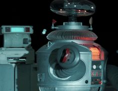 """The aptly named """"Robot B9"""" on the classic TV series Lost in Space was very important not just because he was constantly warning of danger, but also because he was one of the first to be IN a television series. Not to mention that he was voiced by the venerable Dick Tufeld."""