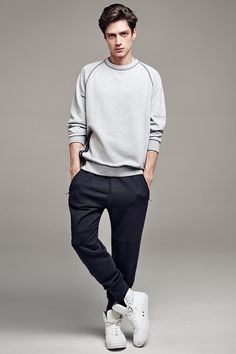 Nice sporty style with white high top sneakers.
