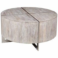 The contemporary and magnificent Desmond Round Coffee Table is fashioned from a sustainable, plantation grown mango wood and adorned with an inlaid iron detail. Topped off with a hand distressed finis