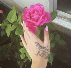 Kali Uchis hand rose tattoo