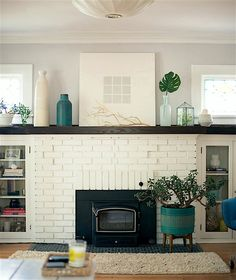 Take a tour of this eclectic Milwaukee home that balances minimalism and bohemia… - Home Professional Decoration Eclectic Fireplaces, Painted Brick Fireplaces, Paint Fireplace, Brick Fireplace Makeover, White Fireplace, Living Room With Fireplace, My Living Room, Home And Living, Fireplace Ideas