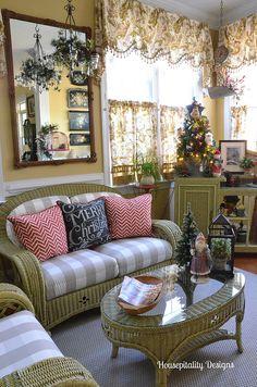Sunroom Christmas 2014-Housepitality Designs I'm loving the Santa, Christmas tree, and lantern on the table!