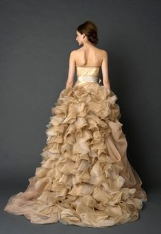 Vera Wang whimsical wedding gown in champagne,  made of pure drama. Enjoy RUSHWORLD boards, WEDDING GOWN HOUND, UNPREDICTABLE WOMEN HAUTE COUTURE and BUDGET PRINCESS COUTURE . Follow RUSHWORLD! We're on the hunt for everything you'll love! #VeraWang #VeraWangBridal #WeddingGown #LuxuryWeddingGown #WeddingGownHound #ChampagneWeddingGown