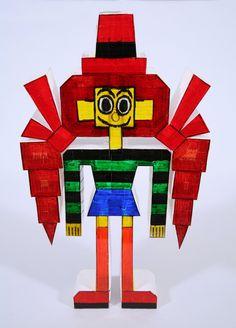 Ishino begon met het maken van deze figuren toen hij in de derde of vierde klas zat en maakt er wel 300 tot 400 per jaar. Deze driedimensionale papieren figuren hebben geen overlappende randen. Hij tekent eerst de voor- en achterkant en voegt ze dan samen met een wit papieren lint en plakband.