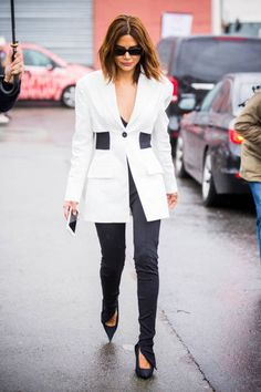 Christine Centenera wearing white jacket and black pants is seen in the streets of Paris after the Balenciaga show during Paris Fashion Week #ChristineCentenera