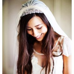 Wear your wedding day jewels in your hair. Place your veil and the Jennifer Behr encrusted Headwrap in your long wavy, straight hair or into a high sleek ballerina bun wedding hair styles.