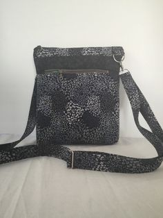 A personal favorite from my Etsy shop https://www.etsy.com/listing/269590884/black-and-grey-neutral-cross-body-bag