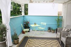 MadeByGirl: My Backyard Patio...re-done! - I love the corrugated metal panels which add privacy and color. This is such a cool porch.