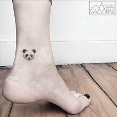small panda head tattoo on the leg