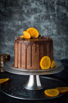 Orange and almond cake with chocolate buttercream - three layers of moist, flavourful vegan orange and almond cake with vegan chocolate orange buttercream, chocolate drip and candied orange slices. Easy to make and perfect for celebrations! Vegan Cake, Vegan Desserts, Dessert Recipes, Orange And Almond Cake, Chocolate Orange, Chocolate Cream, Cupcakes, Cupcake Cakes, Flourless Chocolate