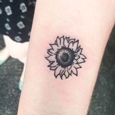 Sunflowers along my side, one for each of my siblings and myself because sun flowers are my favorite flower, and I want something of my childhood in my sibling tattoo