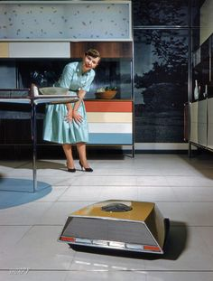 """The 'Retro Roomba"""". """"Anne Anderson in Whirlpool 'Miracle Kitchen of the Future,' a display at the American National Exhibition in Moscow. Mode Vintage, Vintage Ads, Vintage Space, Vintage Posters, Alter Computer, Shorpy Historical Photos, Casa Retro, Futuristic Robot, Futuristic Technology"""