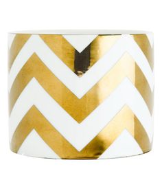 Candle in a ceramic holder with a printed design. Unscented. Height 3 in., diameter 3 1/2 in. Burn time 30 hours.