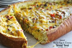 Baked Bacon Egg And Cheese Bread Boat - This breakfast bread boat is filled with bacon crumbles, eggs, cheese, bell peppers and green onion is spectacular.