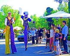 Pelican Hill Italian Street Festa Stilt Walkers.