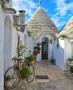 The small houses of Trulli - Alberobello, Italy Places To Travel, Places To See, Places Around The World, Around The Worlds, Beautiful World, Beautiful Places, Old Doors, Windows And Doors, Storybook Cottage