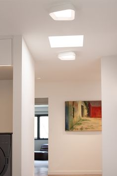 The modern, asymmetric outer metal shade of the Rhonan flush mount ceiling light from Tech Lighting gives way to a recessed acrylic diffusor which effectively controls the powerful LED source. Ideal for hallway, bathroom, or closet lighting.
