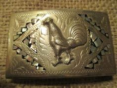 Old-Alpaca-ROOSTER-Fighting-COCK-Inlaid-Hand-Made-Western-Belt-Buckle-$125 or MAKE-OFFER We are OLDWEST on eBay and we have over 1200 buckles listed Here is a link: http://stores.ebay.com/OWN-A-PIECE-OF-THE-OLDWEST E-mail us at oldwest@iland.net